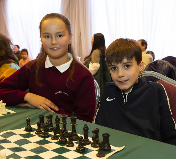 Kyle Shannon from Duncannon NS (right) with Iligana Chudzik, representing Bunscoil Loreto Gorey at the Wexford primary schools chess competition in the Brandon House Hotel