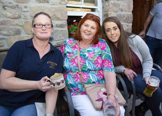Fiona Power from Duncannon with Kathleen White, Nuke and Bernice Turner, Ballyhack at the opening of the new beer garden in the King's Bay Inn