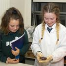 Coláiste Abbáin student Nadia Furlong in the science room with Amy O'Sullivan and Ciara Czere from Clongeen at the school's open night