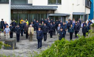 Gardaí, retired gardaí and members of the emergency services observing a minute's silence at New Ross Garda Station on Sunday in memory of Det Garda Colm Horkan