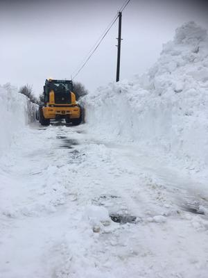 Machinery clearing a path through drifts in North Wexford