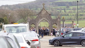 The large crowd gathered inside St Stephen's cemetery during the funeral on Saturday. Photo: Mary Browne