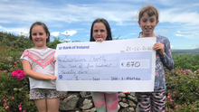 Friends Robyn, Ruby and Olivia with the cheque for LauraLynn
