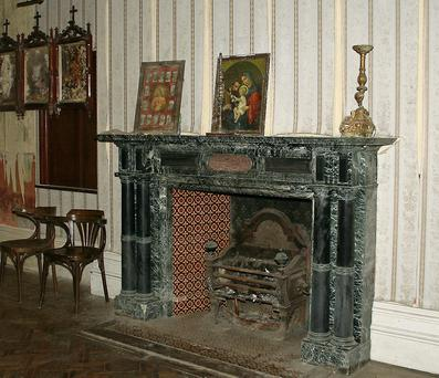 The fireplace inside the church at Loftus Hall