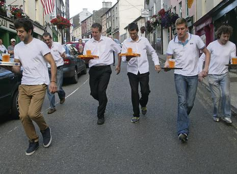 The contestans head out on the barman's race, which was won by Diarmuid Roche (second from right) of Ma Byrne's pub.