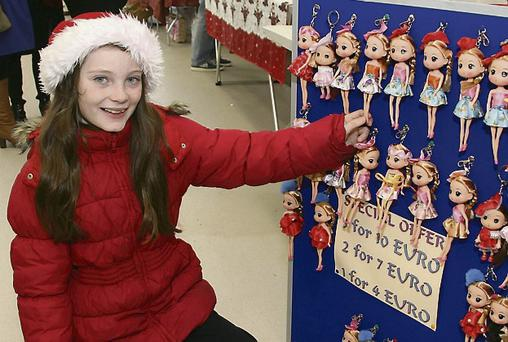 Looking at the dolls at the Christmas Fair in Duncannon Community Hall last Sunday was Jessie Dillon