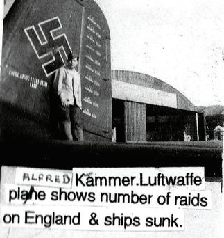 Fr Fritz's cousin Alfred Kammer, a Luftwaffe bomber pilot, with his plane, which shows the ships he sank.