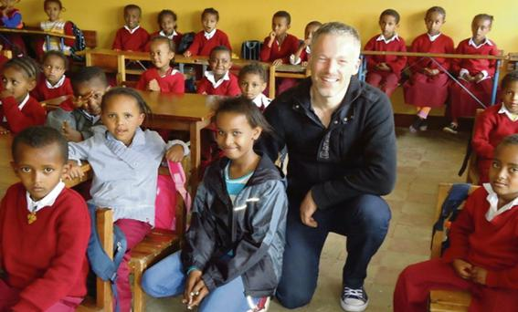 Isabelle with her father Rogier at the school they visited in Ethiopia.