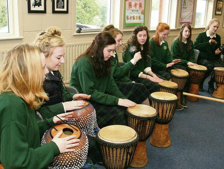St Mary's students using various instruments at their drumming workshop.