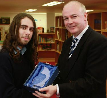 Conor Kelleher, Good Counsel College, New Ross, receives his prize from Professor Vincent Wade.