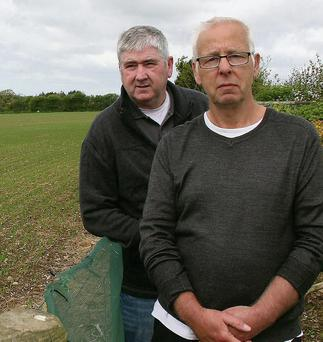 Robert Gerrard and Bernard Holland of Coolroe, Tintern, Ballycullane, beside the field for the proposed development of a solar energy park.