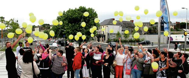 Yellow balloons are released on the quay front in New Rossin memory of those who have died through suicide.