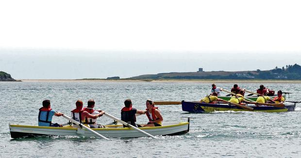 The first class men's race in progress at the St Kearns regatta last Sunday