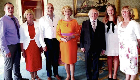 Sean O'Brien, Dorrie Godkin, Bill Stafford, Melanie Cleary and Maureen Clarkin with Sabina Higgins and President Michael D Higgins at the Aras
