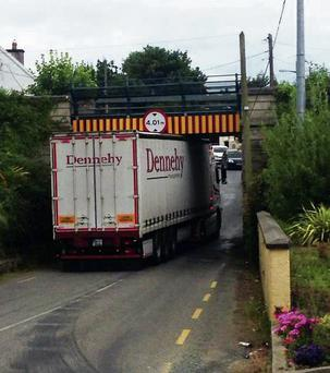 The truck stuck under the railway bridge in Campile