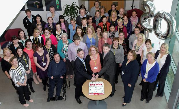Equifax 20th birthday: Longest serving staff members William Murphy, Mary O'Gorman and Gary Maguire cut the cake with management Janice Rudd and Ann Geary and staff