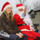 Ellie Byrne giving Santa a lift to Clongeen N.S. last Wednesday on her pony and cart
