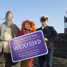 'Norman' Damien Busher, 'Viking' Danielle Reck and 'Light-keeper' Robbie O'Reilly at the launch of Visit Wexford Pass