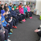 Author Brian Gallagher talking to children from Duncannon N.S. on Friday in New Ross Library