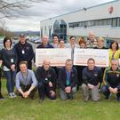 Staff at Lake Region Medical who presented New Ross River Search and Rescue and Down Syndrome Ireland with cheques for £15,000 each at Lake Region Medical last Thursday the money they raised with various fundraisers at the plant throughout the year