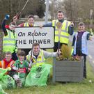Pictured at The Rower, at a An Taisce's Spring Clean are with hurlers Joe Lyng and Kieran Joyce are Joseph Mulholland, James Mahon, Brian Carroll, Willie and David Mulholland