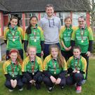 The Clongeen NS team. Front: Hannah O'Grady, Kate Mythen, Amy Doyle and Megan McDonald. Back: Zenya Mullins, Min Allen, teacher and coach Rob Cussins, Grace Donavon and Rachel Bennett