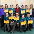 Students from Kennedy College in New Ross who were presented with paired reading certificates in the college, pictured with their tutors
