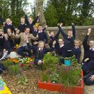Pupils of Clologue National School in Ferns, who will be at Bloom this year with a postcard garden called 'The Seasons', pictured with Marty Morrissey