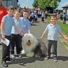 Daniel Teague, Ruari O Dwyer, Nicholas Venn Wall and Robbie Codd with the Dulux dog at Cushinstown N.S. last Tuesday