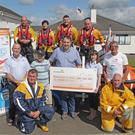 Glana MD John O'Shea presenting Fethard RNLI PRO Rebecca Doyle with the cheque for €950. Also pictured are Joe Dwyer, Eoin Bird, John Colfer, Sam O'Shea, Nicolette Perrella, Malcolm Ennis, Hugh Burke, Noah Burke, Brendan O'Callaghan and Pat Kent