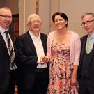 Monsignor Seamus Doyle celebrating his 60th jubilee in the Riverside Park Hotel, pictured with his nephews Brendan and Michael Doyle and niece Aine Doyle