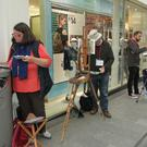 Anne Voss, Kevin Jones and Matthew Ryder on Wexford's South Main Street during Art in the Open's 'Quick Draw'
