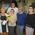 Katie Merrigan presenting Ann Cleere with flowers in the Ross Inn on the occasion of her retiring, from the staff at the Ross Inn after 27 years service. Also in picture are left to right: staff members Karen Merrigan, Ann and Katie, Johnny Hosey proprietor Jo Fahey and back Anthony Connick
