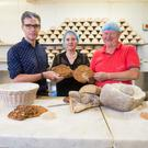 Dr Ben Gearey, Lecturer, Archaeology, UCC; Dr Katharina Becker, Lecturer, Archaeology, UCC and Declan Ryan of Arbutus Bread recreate Iron Age bread-making.