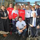 Staff from the Bank of Ireland with staff at the Dunbrody Visitor Centre on board the Dunbrody at the launch of the Bank of Ireland Big Blue Box Volunteer Challenge