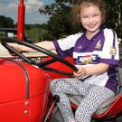 Chloe Byrne McDonald takes the wheel of a vintage tractor