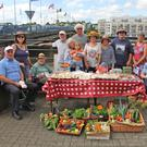 Members of the GIY New Ross Group with their produce on the Quay
