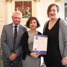 Helen Warner receiving her certificate having graduated