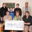 At the presentation of the cheque - front, Christine Meehan; organiser, Eileen Rowe; chairperson, HCSC board of directors, Una Doherty; and vice chairperson, Marge Kehoe. Back- volunteer, Paddy Redmond; organiser, Robin Loughlin with her daughter, Isabella; Linda Meehan; and Jim Mc Cauley, HCSC board of directors