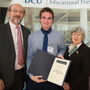 Dylan Brazil being presented his scholarship by DCU President