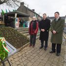 Laying a wreath are Frances Ryan, Eamon O Cuiv TD and Padraig Murphy