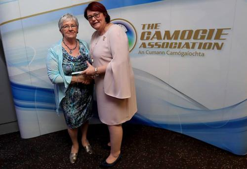 Camogie President Catherine Neary awarding Rose her trophy