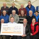 Shamrock Vintage Club presentation of €3,000, from the Pat Byrne memorial road run, to St Abbain's school. Front from left; Cait Bradley parents association, Bill Jackman Shamrock Vintage club, Senan Lillis school principal, Seamus Murphy Shamrock Vintage club and Pauline Colfer parents association