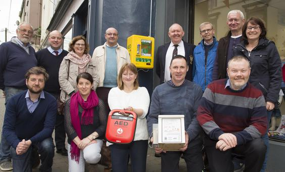 The new defibrillator in South Street, sponsored by the 'Split the Pot' weekly draw by New Ross Rugby Club, New Ross Swimming Club, St. Joseph's Athletic Club and New Ross Boat Club