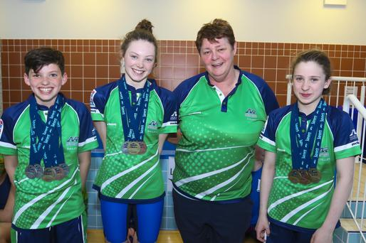 Swimmers from New Ross swimming club who competed in the Ulster Age groups and Youth Championships. Evan Bailey, New Ross gold 100m freestyle, silver 400m freestyle, silver 200m IM, silver 100m breaststroke, silver 100m butterfly and bronze 100m backstroke; Sadhbh Bailey, New Ross gold 400m freestyle, silver 800m freestyle and bronze 100m freestyle; Fran Ronan coach and Abi Cullen Bree gold 100m freestyle, gold 200m IM, gold 400m freestyle and bronze 100m butterfly