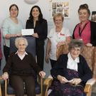 Members of the fundraising committee and the hospital staff at the cheque presentation at New Ross Community Hospital