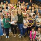 Horeswood Musical Society presentation by Ellie Whitty and Julie Ronan of €3,100 to Olive Ruanne of Pieta House