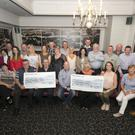 Pictured receiving the cheques from the Laugh for Hope and Hospice fundraiser which raised €11,000 were Paddy Redmond from the Hope Centre in Enniscorthy and Anthony Connick and Ann Sommers from the Wexford Hospice