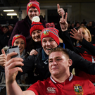 Tadhg Furlong poses for selfies with Lions fans after last Saturday's game against the Crusaders