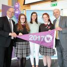 Among the schools being awarded the flag was Meánscoil Gharman, Inis Córthaigh, Loch Garman. Students Abbey Kennedy and Jade Buttle proudly accepted the flag on behalf of their school